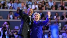 President Barack Obama and Democratic Presidential candidate Hillary Clinton wave together during the third day of the Democratic National Convention in Philadelphia , Wednesday, July 27, 2016. (AP Photo/Mark J. Terrill)